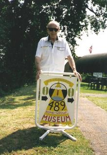 David Neale presents sign he designed and made, 1996