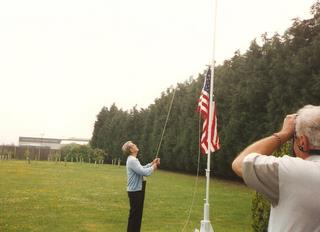 1997 - Dave Glick raises the flag at the 489th Memorial
