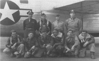 Crew photo - Back Row R-L: Lt A R Williams, Bombardier.  Lt Howard W Kieffer, Navigator.  Lt E T Davis, Co-Pilot. Lt J F Woerner, Pilot.  Front Row R-L: AG Sgt W S House, Nose Genner. E Sgt R H Sanderford, Engineer. AE Sgt A P Meehan, Tail Gunner. G Sgt C