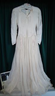 Helen McMullen's parachute wedding dress on display in the 489th Bomb Group Museum