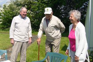 489th Veteran John Lamar with Normandy Veteran David Woodrow share a joke with Pam Wilby