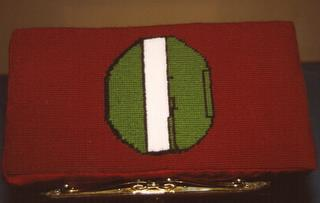 Green tail - Church kneeler stitched by Helen Plate whose husband, 489th veteran Wilmer Plate, was Pilot on B-24 'Plate's Date'