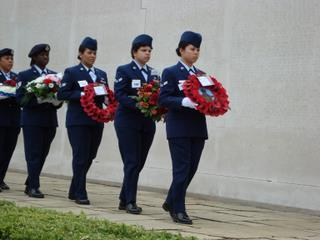 The wreath carriers (military volunteers) move into position along the Wall of the Mission